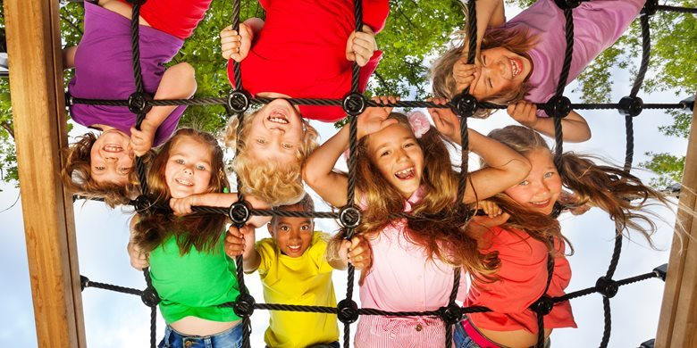 9541043-many-kids-look-though-gridlines-of-playground.jpg