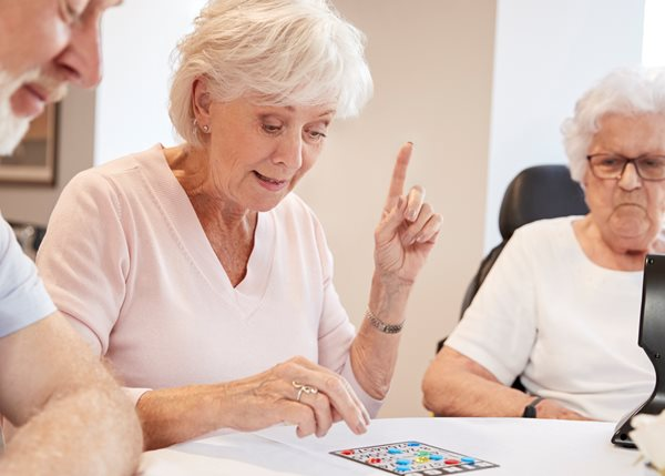 29401316-group-of-seniors-playing-game-of-bingo-in-retirement-home.jpg